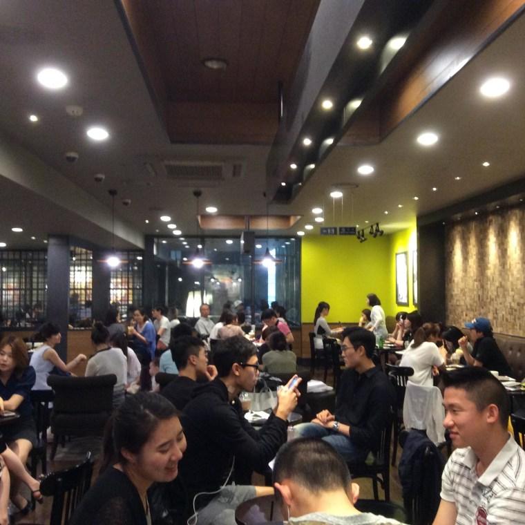 A crowded Starbucks coffee shop in Seoul, South Korea.