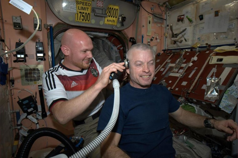 German astronaut Alexander Gerst shaves the head of American astronaut Steve Swanson as they follow-through on a World Cup bet aboard the International Space Station on June 26.