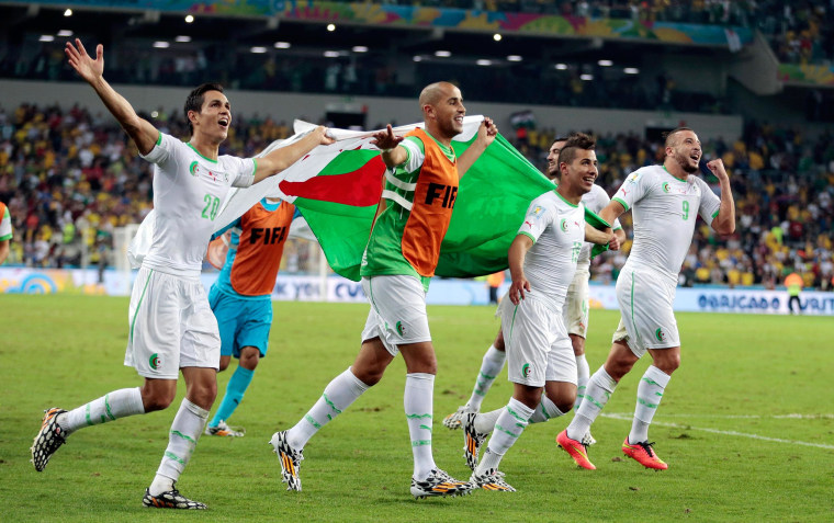 Image: Algerian players celebrate after the group H World Cup soccer match between Algeria and Russia at the Arena da Baixada in Curitiba, Brazil