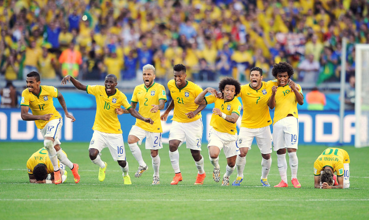 Image: Brazil celebrates after winning the penalty shoot-out during the 2014 FIFA World Cup Brazil Round of 16 match between Brazil and Chile