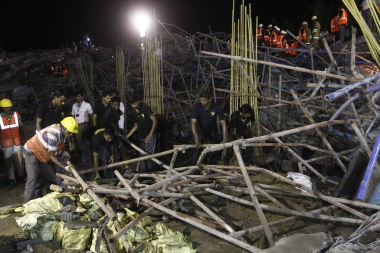 Image: Rescue workers conduct a search operation for survivors at the site of a collapsed 11-storey building that was under construction on the outskirts of Chennai