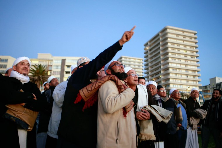 Image: South African muslims gather on the beach front in Cape Town