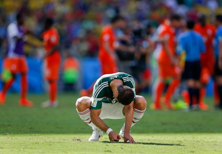 Mexico's Javier Hernandez punches the ground after the Netherlands defeated Mexico 2-1 to advance to the quarterfinals during the World Cup round of 16 soccer match between the Netherlands and Mexico at the Arena Castelao in Fortaleza, Brazil, Sunday, June 29, 2014.