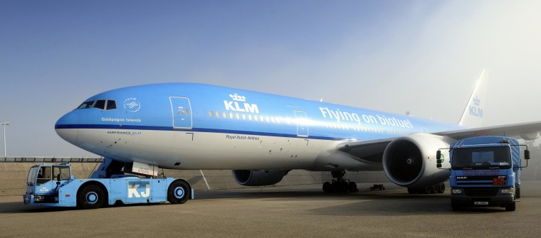 A KLM Royal Dutch Airlines airplane sits ready for take-off at Schiphol Airport.
