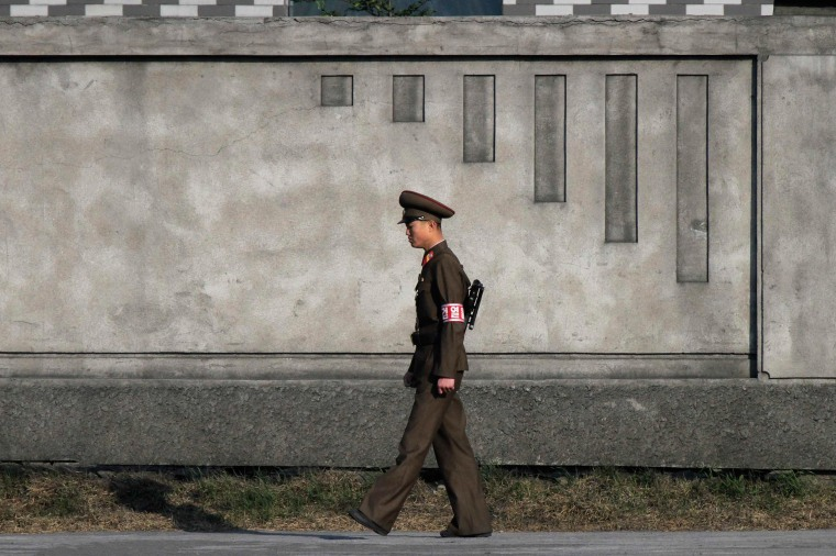 Image: A North Korean soldier patrols on the banks of the Yalu River near the North Korean town of Sinuiju