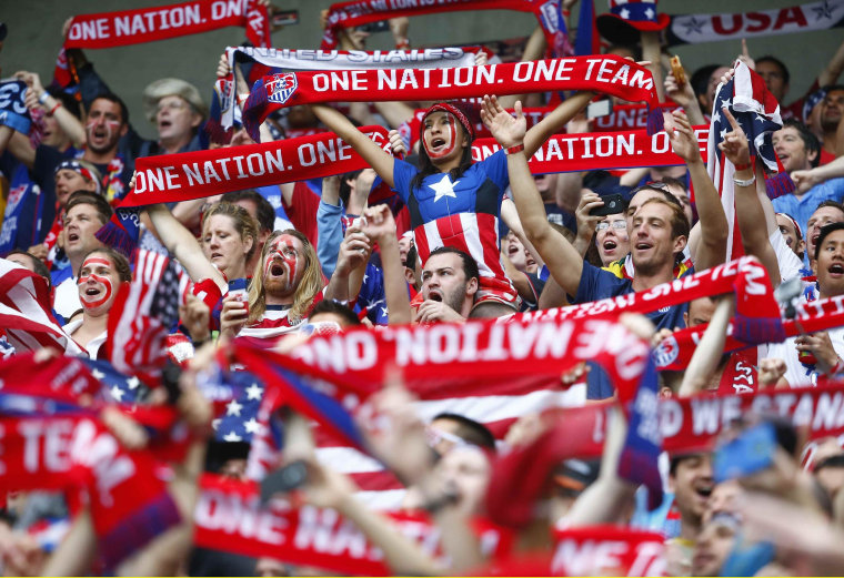 Image: U.S. fans cheer before the start of the 2014 World Cup Group G soccer match against German at the Pernambuco arena in Recife
