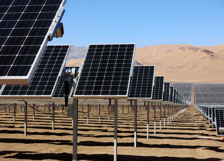 Image: Solar panels of local mining company CAP are seen in the Atacama Desert