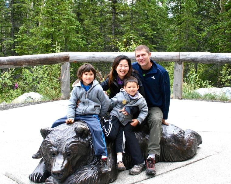 Kurt Dittmar and Christine Wu-Dittmar, with their sons Lukas (6) and Nikolas (9).