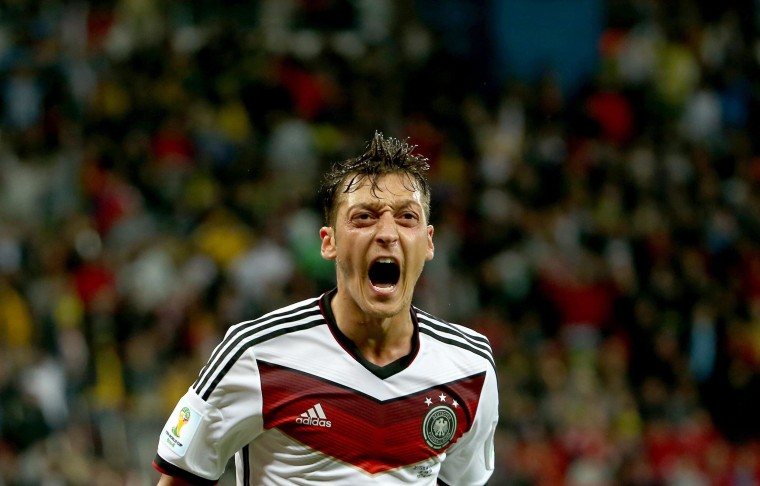 Mesut Oezil of Germany celebrates scoring during the FIFA World Cup 2014 round of 16 match between Germany and Algeria at the Estadio Beira-Rio in Porto Alegre, Brazil, on June 30.