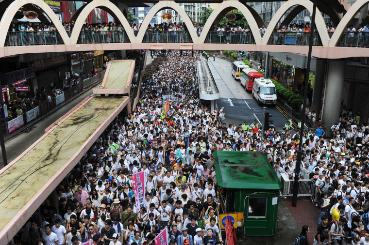 Protesters march during a pro-democracy rally in Hong Kong on July 1, 2014 as frustration grows over the influence of Beijing on the city.