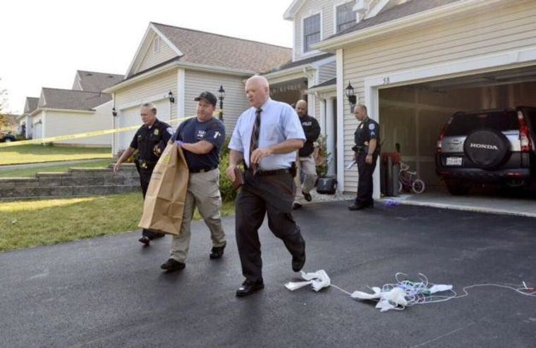 Image: Evidence is removed from the scene of a murder suicide at 58 Rockrose Drive in East Greenbush, N.Y., on July 1.