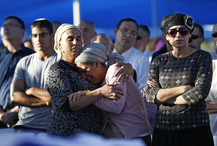 Image: Shaer and Yifrah, mothers of two of the three Israeli teens abducted and killed in the West Bank, mourn during the joint funeral of their sons in Modi'in