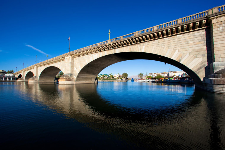 London Bridge spans the Colorado River at Lake Havasu City, Ariz., on Oct. 25, 2012. The London Bridge is not falling down, despite a British tabloid saying that the Lake Havasu City tourist attraction is being bulldozed to make way for drug tourism. Lake Havasu City officials heard about the story in The Sun after a local resident visiting the United Kingdom brought back a copy of the tabloid. They say it was a slap in the face and demanded a retraction and an apology.