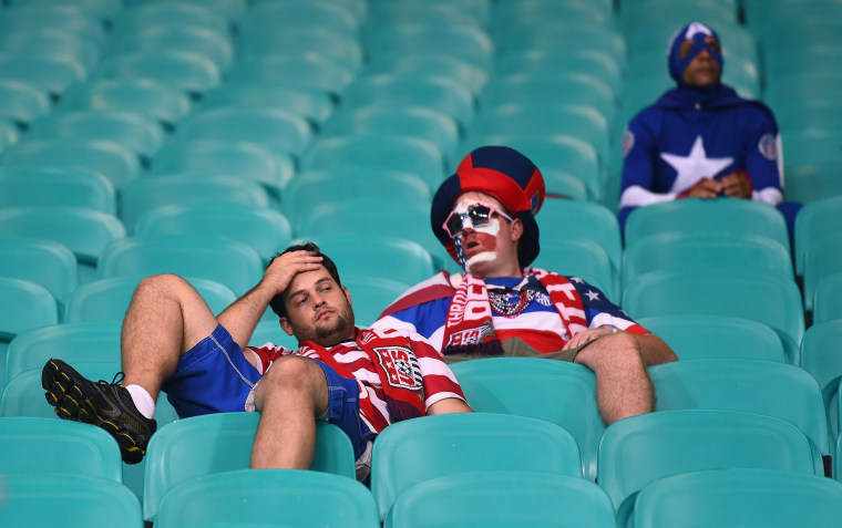 Image:Dejected United States fans look on after being defeated by Belgium 2-1