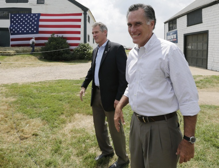 Mitt Romney, the former Republican presidential nominee, stands with New Hampshire Senate candidate Scott Brown, left, as they wait to be introduced during a campaign stop at a farm in Stratham, N.H., Wednesday, July 2, 2014.  Brown, who is facing incumbent Democrat U.S. Sen. Jeanne Shaheen, was endorsed by Romney at the event.