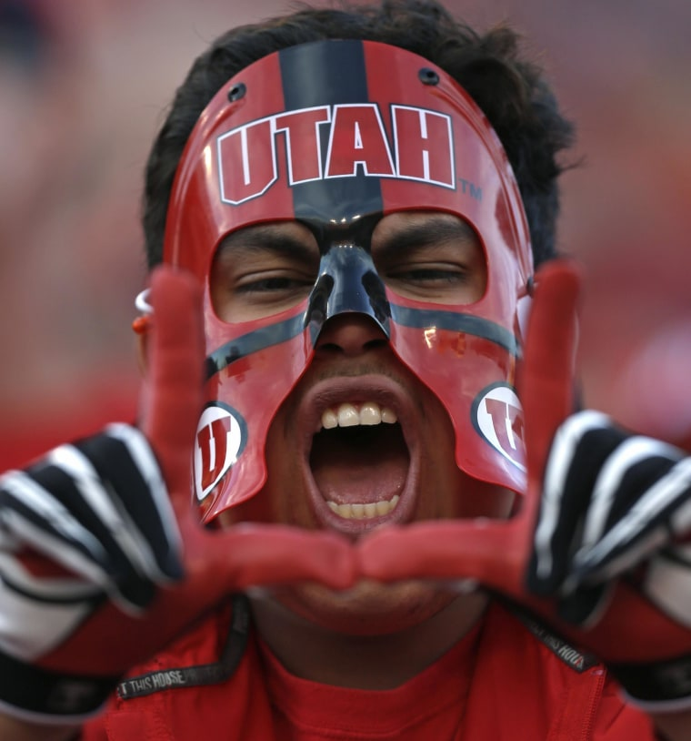 "A Utah fan shouts in the second half during an NCAA college football game against Arizona State, in Salt Lake City on Nov. 9, 2013. The University of Utah has tweaked its official fight song, offering an alternate choice for its signature line while replacing others altogether amid concerns the former version was sexist. The new version doesn't officially change the lyrics from ""I'm a Utah man"" to ""I'm a Utah fan."" Instead, it lists both; singers can choose their preference. But the line ""coeds are the fairest"" is officially out."