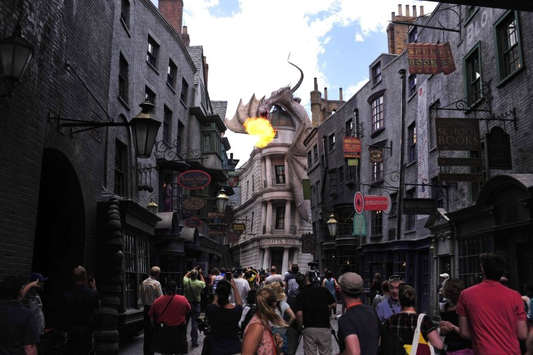 Image: A dragon breathes fire above The Wizarding World of Harry Potter-Diagon Alley