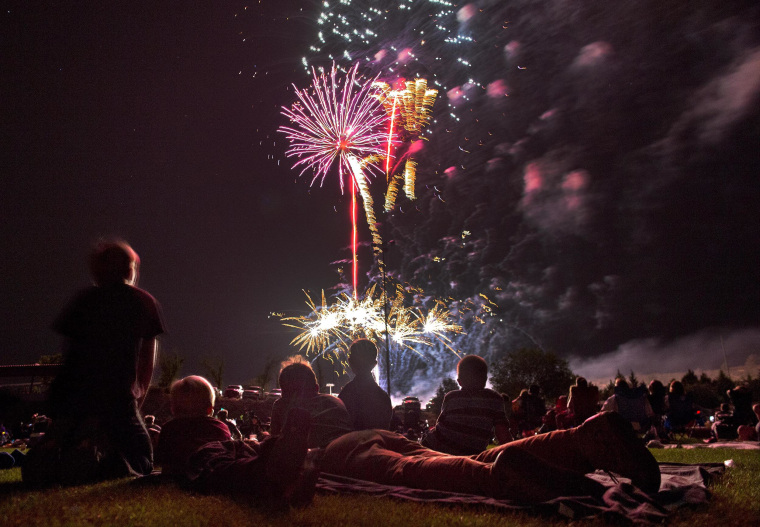 Spectators watch as fireworks explode overhead during the Fourth of July celebration at Pioneer Park, Thursday, July 4, 2013 in Prescott, Ariz.