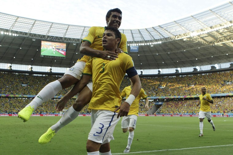 Image: Thiago Silva (front) of Brazil celebrates his 1-0 goal during the FIFA World Cup 2014 quarter final match between Brazil and Colombia