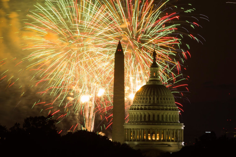 Image: Fireworks illuminate the sky over the U.S. Capitol building and the Washington Monument during Fourth of July celebrations