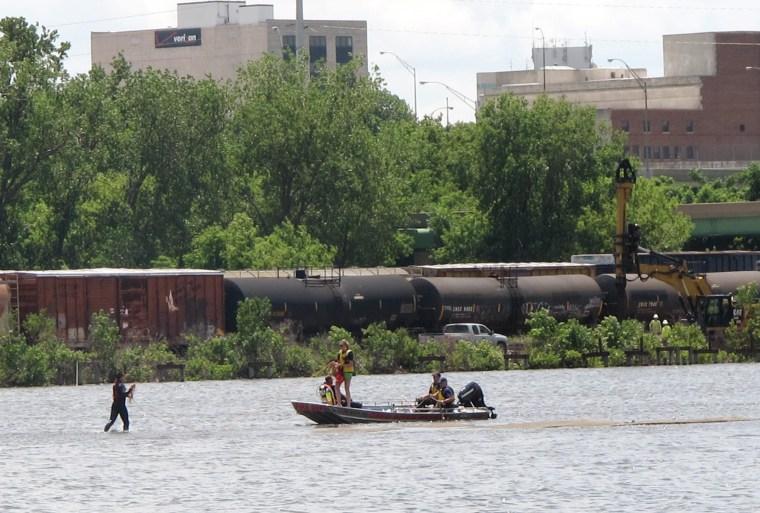 Image: A rescue team searches Cedar Lake for Logan Blake in Cedar Rapids, Iowa.
