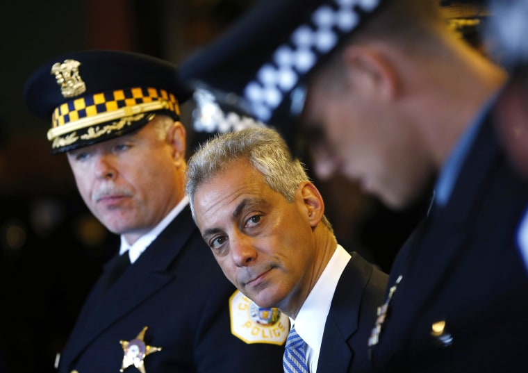Image: Mayor of Chicago Rahm Emanuel looks over at one of the Chicago Police Department's newest recruits prior to their graduation ceremony for in Chicago