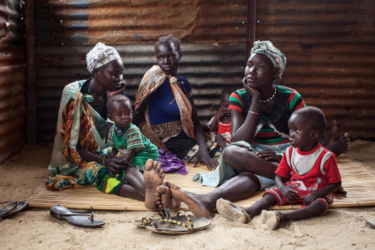 Image: Families with malnourished children wait to receive treatment at the Leer Hospital in South Sudan, on July 7.