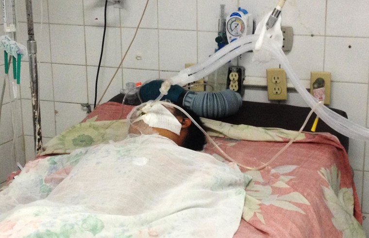 Image: A dying child rests in a hospital bed