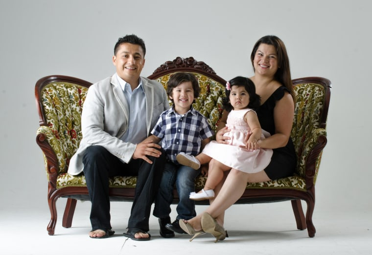 A family photo of Gabriela Garcia Hernandez, a teacher, and her husband Luis Carlos Hernandez, a software engineer, with their two children. The Texas couple want to become international foster parents to help a Central American child who recently crossed the border.