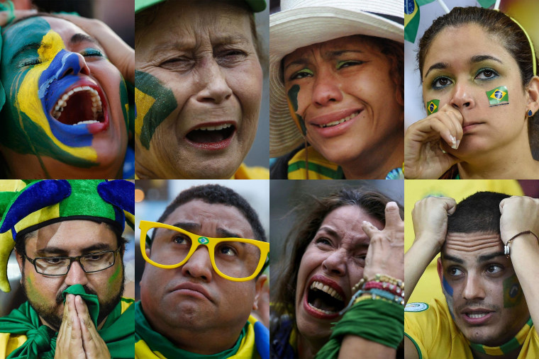 Image: Brazil fans react in anguish as Germany dominates Brazil during their semifinals World Cup match.