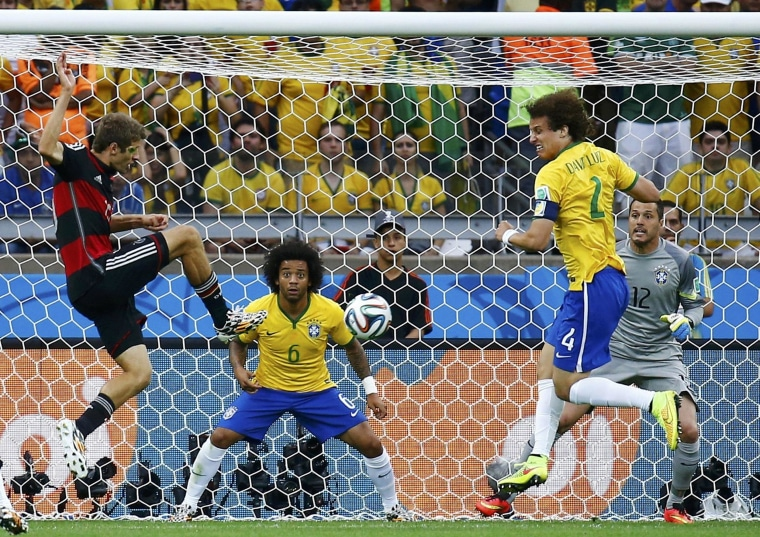 Image: Germany's Mueller scores the team's first goal watch during their 2014 World Cup semi-finals against Brazil at the Mineirao stadium in Belo Horizonte