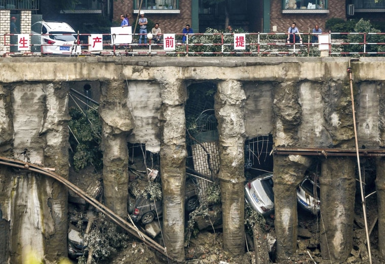 Image: Cars are seen in a sunken open-air parking lot after heavy rainfall hit Chengdu