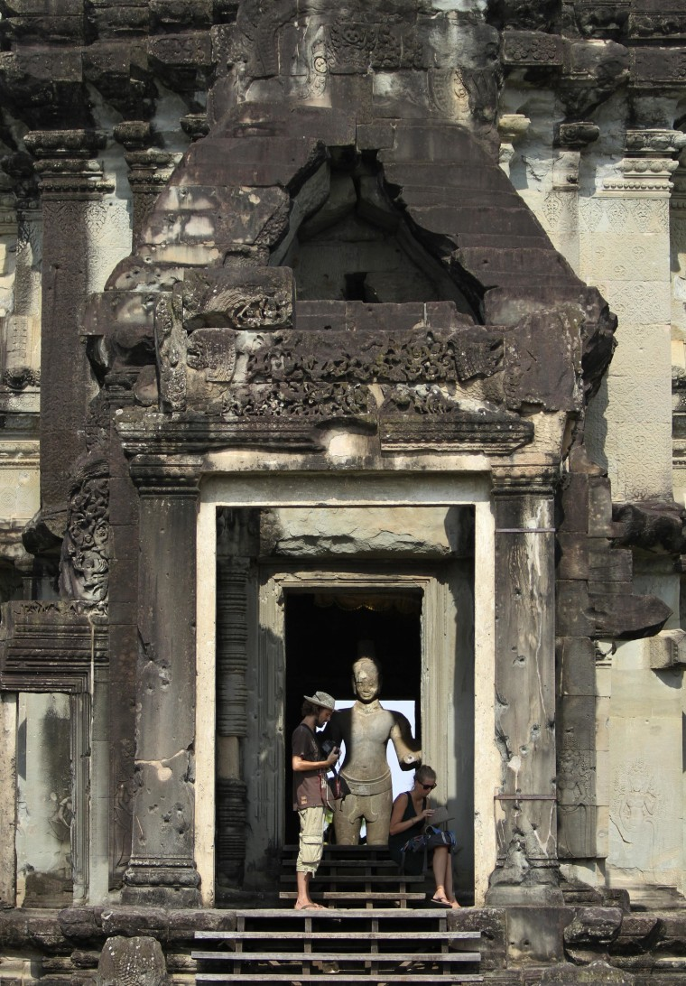 Image: Tourists visit the Angkor Wat temple complex in Siem Reap province