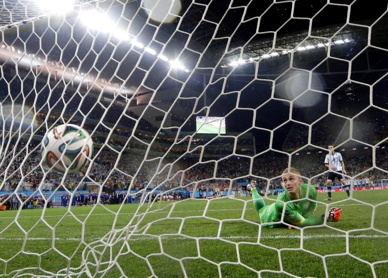 Image: Argentina's Maxi Rodriguez shoots the winning shot against Netherlands' goalkeeper Jasper Cillessen during a penalty shootout after extra time during the World Cup semifinal soccer match between the Netherlands and Argentina