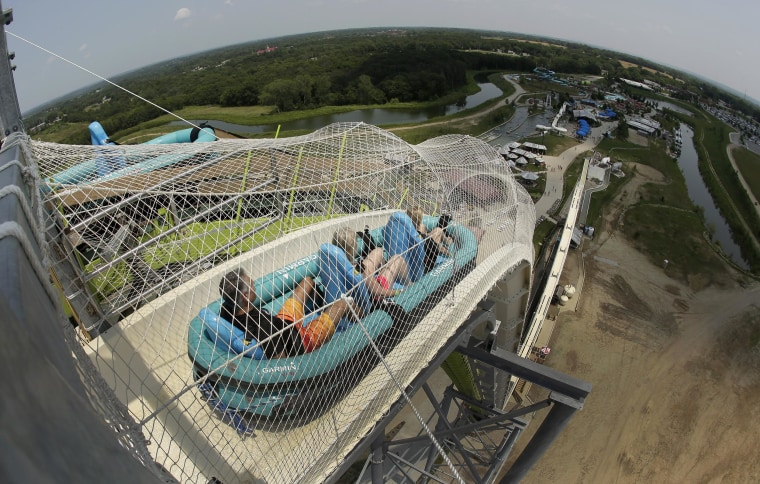 """Image: Riders go down the world's tallest water slide called \""""Verruckt\"""""""