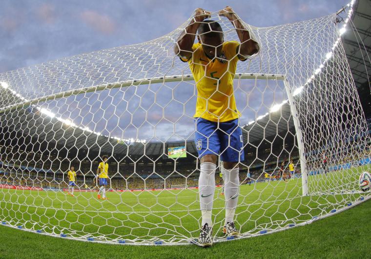 Image: Fernandinho of Brazil reacts after a goal scored by Toni Kroos of Germany