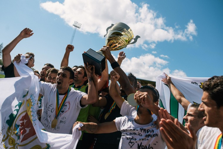 Countea de Nissa's players hold the trophy aloft as they celebrate their victory in the final.