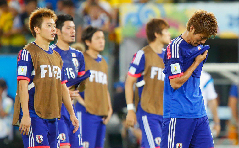 A dejected Manabu Saito and Yoichiro Kakitani of Japan after defeat in the 2014 FIFA World Cup Brazil Group C match between Japan and Colombia at Arena Pantanal on June 24, 2014 in Cuiaba, Brazil. Japan joined the other three Asian teams at the World Cup in not advancing to the Group of 16 stage.