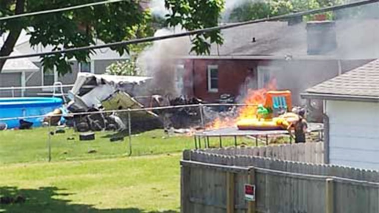 Image: The pilot of a small plane that was departing from Greenwood's airport died when the plane struck a home