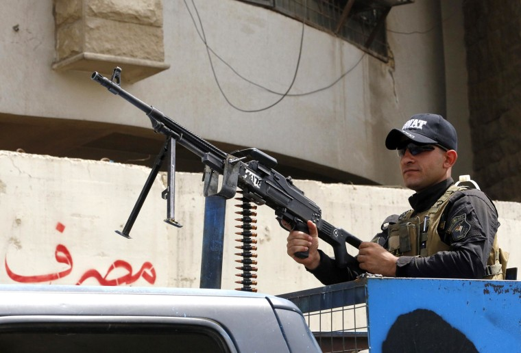 Image: An Iraqi policeman guards an area in Baghdad's Ferdous Square