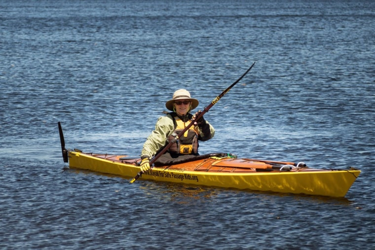 Deborah Walters poses in the custom-built kayak donated by one of her many sponsors. In it, she will travel from Maine to Guatemala to raise money and awareness for Safe Passage, a non-profit that supports children in the Central American country.