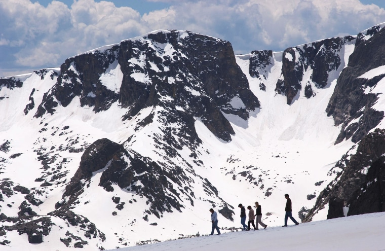 Image: People walk near the Trail Ridge Road in Rocky Mountain National Park, Colo