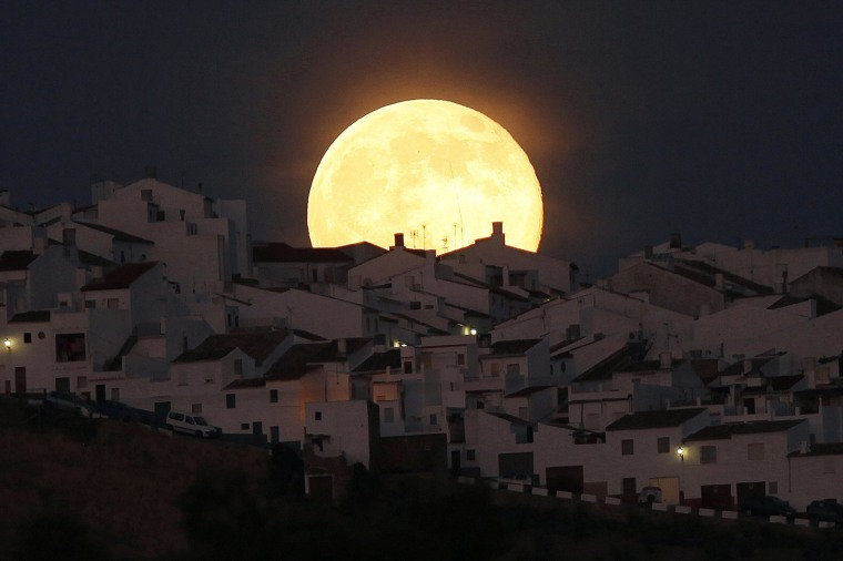 The Supermoon rises over houses in Olvera, in the southern Spanish province of Cadiz, on July 12. Occurring when a full moon or new moon coincides with the closest approach the moon makes to the Earth, the Supermoon results in a larger-than-usual appearance of the lunar disk.