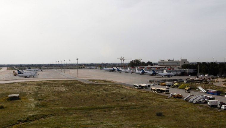 Image: Airplanes are seen at the airport in Tripoli