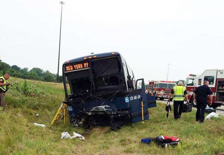 Image: A Greyhound bus and car collided on a highway near Indiana's border with Ohio, killing one person and injuring at least 18 others.