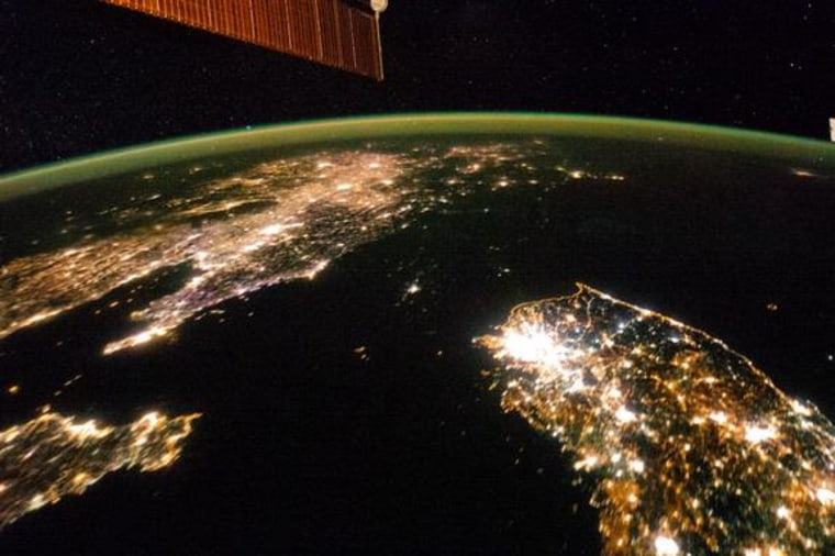 In this image, snapped from the International Space Station on Jan. 30, 2014, while South Korea (lower right) and China (upper left) are aglow in lights, poverty-stricken North Korea is really in the dark.