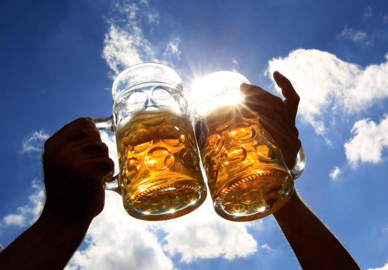 Revellers toast with beer during the 179th Oktoberfest in Munich September 28, 2012. Millions of beer drinkers from around the world will come to the Bavarian capital for the 179th Oktoberfest, which runs until October 7, 2012.