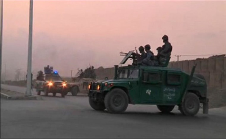 Image: Video still shows Afghan security personnel on vehicles as an area near the Kabul airport comes under attack