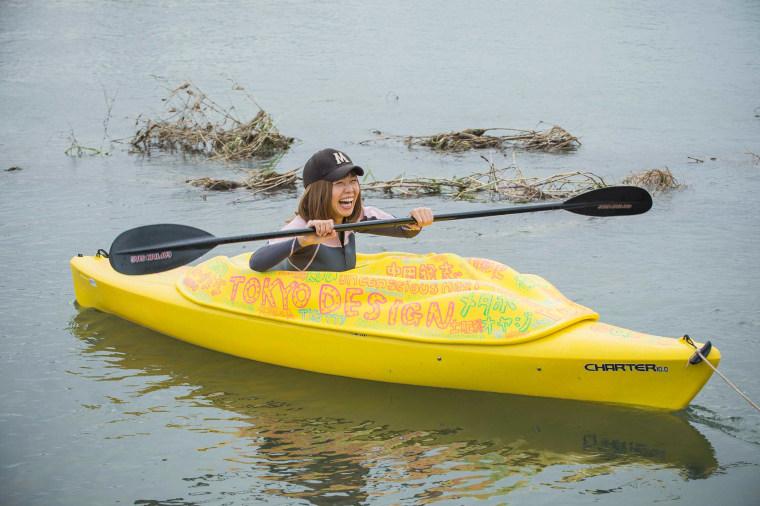 Image: Japanese artist Megumi Igarashi, known as Rokudenashiko, paddles in her kayak modeled on her vagina