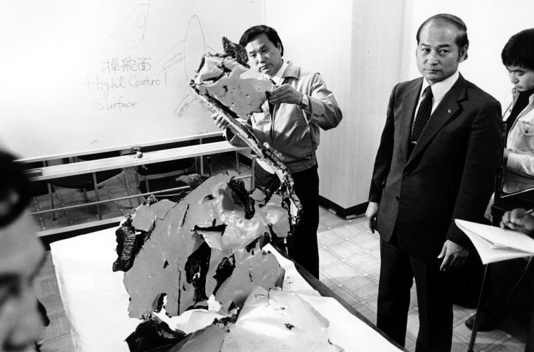 Image: Korean Airlines equipment procurement section chief Suk Jin-Ku examines a piece of aircraft debris at Wakkania Police station in Japan on Sept. 12, 1983.
